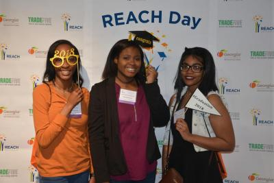 Three girls pose for a picture at REACH Day at the Capital