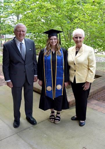 REACH Scholar and University of North Georgia graduate Laura Vinson (center) with former Governor Nathan Deal (left) and former First Lady Sandra Deal.